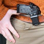What are some of the questions to ask yourself before buying a gun holster?